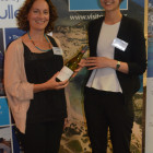 Sarah Martin Travel Counsellors wins a bottle of wine from Travel Bulletins Gemma Reeve
