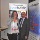 Claire Mitchell of Thomas Cook Castle Vale, winner of a bottle of Havana Club Rum pictured with Miguel Chang of the Cuba Tourist Office