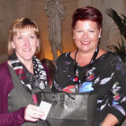 Claire Waldron of Highworth Travel (left) receives a Hard Rock goody bag from Fiona Moss of Hard Rock Hotels All Inclusive Collection.