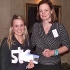 Rebecca Bunn of STA Travel (left) receives her prize of 7 nights stay on B&B at the True Blue Bay Boutique Resort from Denise Greene from Sunrise Marketing.