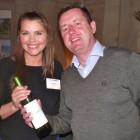 Winner of Caribbean Bingo bottle of wine Shellie Jones of Kuoni, receives her prize from Travel Bulletin's Bill Coad.