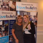 Jeanette Ratcliffe Travel Bulletin presenting Rachel Howes with a bottle of wine for winning the Bingo!!