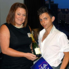Raffle Winner #1 : Sharon Tait of Titan presents champagne and chocolates to Elliot Walker of Honeymoon Dreams