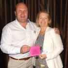Raffle Winner #7: Dominic Carrick of If Only presents Kay Oram of The Travel Shop with her prize of a £60 Debenhams voucher