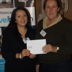 Nicola Johnson (left) from Lux Resorts presents Carolyn Pack from C The World with a £100 Love2Shop voucher.