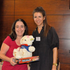 Charlotte Mendoza, Carnival (right) presents Gloria Gilbert, Colletts Travel Limited with a Carnival Teddy and Connect 4 game.