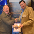 Mercer Travel's David Mercer, winning a gift card from Duncan McCubbin ( North Carolina )