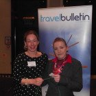 Nicola Roworth, Travel Lounge Chorley, receiving her Lindt Chocolate Bunny from Jane Fraser, Travel Trade Co-ordinator from Destination British Coloumbia