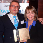 Prize Draw Winner of a box of Belgian Chocolates: Sean Phillips of Thomas Cook Wimbledon, receiving his prize from Jeanette Ratcliffe of Travel Bulletin
