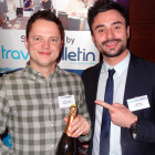 Prize Draw Winner of a bottle of champagne: George Gregory of Flight Centre, receiving his prize from Matt Gill of Travel Bulletin