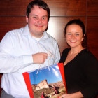 Prize Draw Winner of 2 Bottles of Wine: Ben Burgess of Dialaflight, receiving his prize from Nina Farrimond of South African Tourism