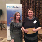 Joan Toker, Business Development Manager Sunset Faraway Holidays gives £50 shopping voucher prize to Emma Fountain from ITC