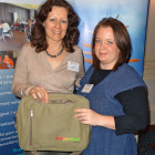 Dawn Parr of Botswana Tourism presents Karen Gregory of Zephyr Holidays with a Bostwana Tourism Briefcase Bag
