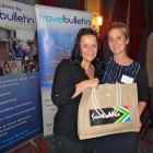 Nina Farrimond of South Africa Tourism presents Rachel Hailstone of Bath Travel with a bottle of South African red and a bottle of South African white wine