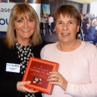 Jeanette Ratcliffe from Travel Bulletin hands a box of chocolates to the lucky Lorinda Webb from Travel Counsellors
