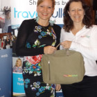 Travel Counsellor's Cornel Schalkwyk wins a Botswana briefcase from Dawn Wilson, Botswana Tourism