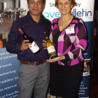 Khaled Shiraj from Sam Travel wins 2 bottles of wine from 2By2 Holidays Claire Farley