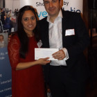 Sophie Sheth from Travel Counsellors winning a £100 Love2Shop voucher from Lee Barker, One & Only Resorts