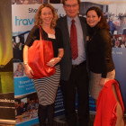 Jane Fraser, Destination British Columbia and Lyn Naylor, Travel Alberta hand Frank Bellairs from Gifto Travels a Red Leather Goody Bag