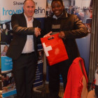 Nick Robb, Switzerland Tourism gives winner Kayode Obijole from Peacock Travel and Tours a Swiss Chocolate Hamper