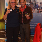 Sarah Johnson from Andorra gives Niaz Choudhury, Sam Travel the £50 Blacks Voucher Prize
