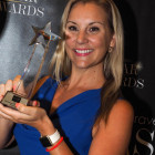 Casey Mead shows off G Adventures' award for Star Adventure/Activity Holidays Operator.