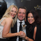 The award for Star Luxury Cruise Company went to Silversea Cruises. Pictured are the line's Donatella Valzasina (left) and Helen Crosbie with Travel Bulletin's Bill Coad.