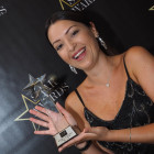 A delighted Natasha Richardson from P&O Cruises collects the award for Star Cruise Company for Training, Incentives & Fam Trips.