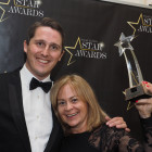 Tom Bell and Clare White from bedsonline celebrate winning the award for Star Accommodation-Only Provider.
