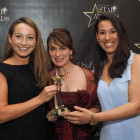 Vicky Robinson (left) and Areti Varvaresou from Emirates are pictured collecting the award for Star Business Airline with award sponsor Mandy Haque (centre) from Birmingham Airport.