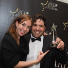 Celebrating Visit California's win of Star Destination for Escorted Tours is Emma Westman and Brendan Croft.