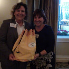 Carol Kirkham, Kirkham Travel Limited receives Bahamas Tourist Office goody bag from Maria Grazia Marino, Bahamas Tourist Office