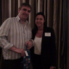 Ralph Warrington, Travel Counsellors collects a bottle of champagne from Jane Bolton from Couples Resorts