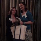 Caroline Hoyle of STA Travel wins a Sunrise Marketing goody bag presented by Denis Greene