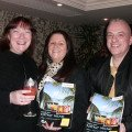 Sharon Earls (centre) from Cosmos shows Laura Cox and Peter Rogers from Cruise 1st the operator