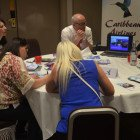 Agents take notes throughout the lively Caribbean Airlines presentation