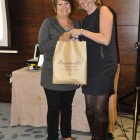 Julie Greenhill, Massachusetts (right) presents Suzanne Seed, Travel Counsellors with a Massachusetts goody bag.