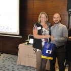 Julie Franklin, All Leisure Holidays presents Alex Garcia, Steamond Travel with an All Leisure gift bag.