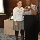 Andrea Sims, Visit California (left) presents Sarahlee Ettienne; Thomas Cook Marble Arch with an iPod Shuffle