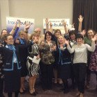 13 of the Agents celebrating their winning prizes