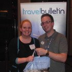 Meade Sellers from Thomas Cook Sale receiving her Disney Goody Bag from Russell Mears, Field Sales Exec, Disney Destinations