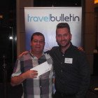 Kevin Pugh from Holiday Getaway with Avis's Mark Cornock winning a £50 Love to Shop Voucher