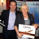 Simon Eddolls of Travel Bulletin presents Bingo Prize 1 – a box of Belgian Chocolates – to Sara Allen of Dartmouth Travel Company
