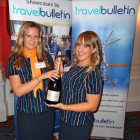 Meghan Potter of Bath Travel Netwon Abbott and Rebekah Yelland of Bath Travel Honiton share Bingo Prize 2 – a Magnum of champagne