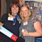 Angela Price of South African Airways presents Vickie Leriche of STA Travel with a bottle of SAA onboard wine