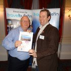 Tony Byrne of Great Rail Journey congratulates Ian Goodenough of Big Blue Marble with a £50 Love2Shop voucher