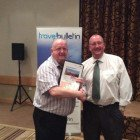 Tony Byrne National Sales Manager Great Rail Journeys presenting Sion Jones from Teithiau Menai Travel with prize of £50 L2S voucher.