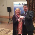 Ann Jones from Teithiau Menai Travel wins selection of wine from Justin Coles, Business Development Manager, Somak Holidays.
