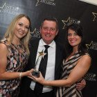 Travel Bulletin's Bill Coad pictured with Travel 2's Hollie Smith (left) and Carla Hutchings as they win the award for Star Long Haul Operator