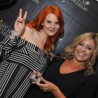 Lucy Preece (left) and Sarah Weetman collect Royal Caribbean International's award for Star Family Cruise Company.
